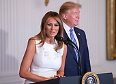 United States President Donald J. Trump and First lady Melania Trump participate in the Celebration of Military Mothers in the East Room of the White House in Washington, DC on May 10, 2019.<br /> Credit: Ron Sachs / CNP