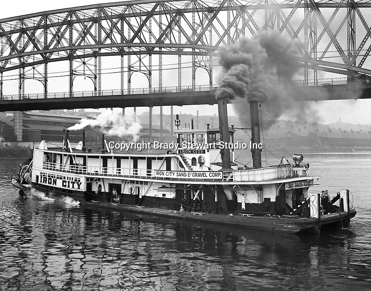 Pittsburgh PA:  Sir Iron City Tugboat operating on the Monongahela River - 1953