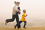Woman running with her son on the bluffs at Panorama Park, Bakersfield, California.