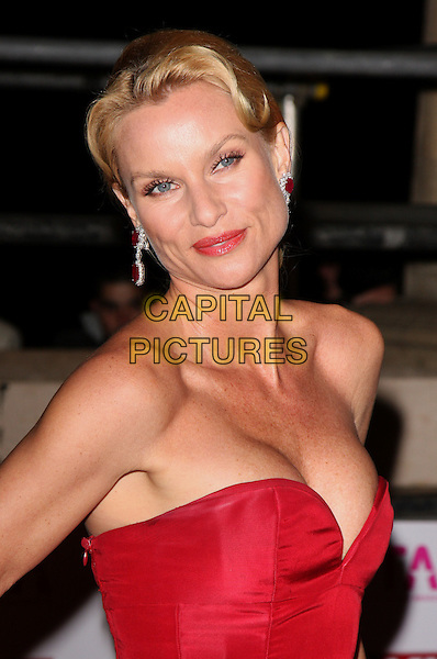 NICOLLETTE SHERIDAN.The National Television Awards held at the Royal Albert Hall, London, England. .October 29th, 2008 .NTA red carpet arrivals half length red strapless nicolette earrings .CAP/ROS.©Steve Ross/Capital Pictures.