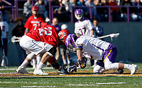 UAlbany Men's Lacrosse defeats Stony Brook on March 31 at Casey Stadium.  Stony Brook's Nolan Enneguess (#32) competes with Albany's TD Ierlan (#3) at the X.