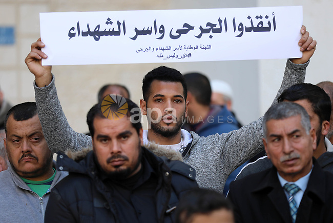 Palestinian families of martyrs take part a protest to demand their rights and salaries, in Gaza city, on February 12, 2019. Photo by Mahmoud Ajjour
