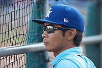 Lexington Legends athletic trainer Saburo Hagihara watches the action from the dugout during the game against the West Virginia Power at Appalachian Power Park on June 7, 2018 in Charleston, West Virginia. The Power defeated the Legends 5-1. (Brian Westerholt/Four Seam Images)