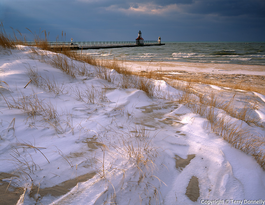 St Joseph, MI   <br /> St Joseph Pierhead Light from the windswept snow covered dunes of North Beach