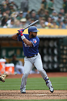 OAKLAND, CA - APRIL 5:  Elvis Andrus #1 of the Texas Rangers bats against the Oakland Athletics during the game at the Oakland Coliseum on Thursday, April 5, 2018 in Oakland, California. (Photo by Brad Mangin)