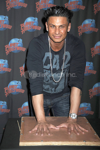 "Pauly D (Paul DelVecchio) Promotes the Upcoming Season of MTV's ""Jersey Shore"" with a Handprint Ceremony at Planet Hollywood in NYC on November 30, 2011. © mpi01/MediaPunch Inc."