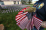 Members of the Western Nevada College Veterans Resource Center and other volunteers plant thousands of American flags at WNC, in Carson City, Nev. on Friday, May 6, 2016. The flags represent the more than 8,000 veterans who commit suicide each year.   <br /> Photo by Cathleen Allison/Nevada Photo Source