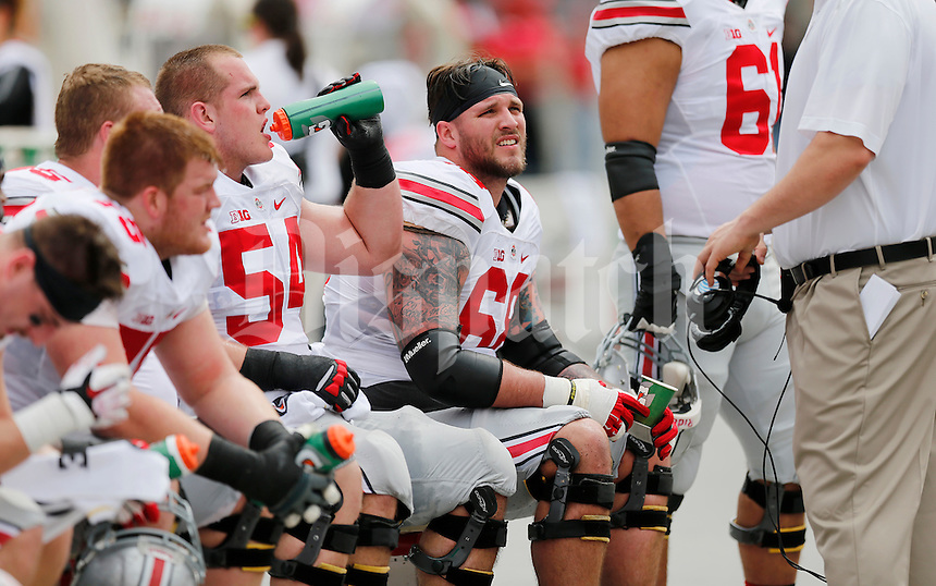 The Offense team #54 Billy Price, and #68 Taylor Deckerin the first half of the Ohio State Spring Football Game Saturday, April 18 2015.  (Dispatch Photo by Courtney Hergesheimer)
