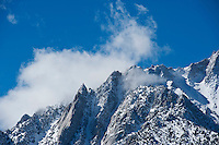 Clouds clear from mountain ridge, Sierra Nevada Mountains, California