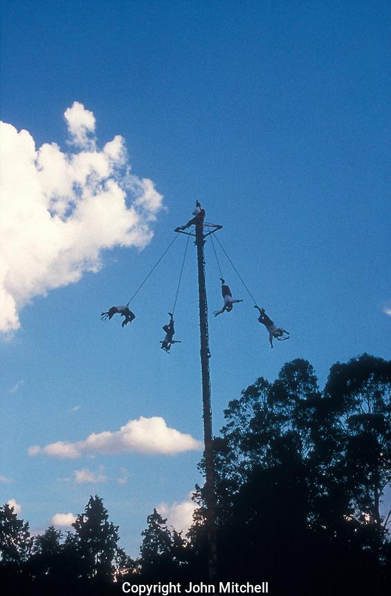 Voladores or fliers performing their sacred aerial dance at the Totonac ruins of El Tajin, Veracruz state, Mexico. El Tajin is a UNESCO Wold Heritage site.