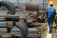 A worker stands amidst piles of steel products at a trading stockyard in Shanghai, China. The demand for steel has increased dramatically with the country's rapid economic expansions. However the government has recently announced a price hike in industrial-use electricity to discourage blind and unauthorized expansions in some power-hungry industrial sectors and ordered a halt in production of steel beams used in constructions in an attempt to cut electricity shortages expected for the incoming summer..17-JUN-04