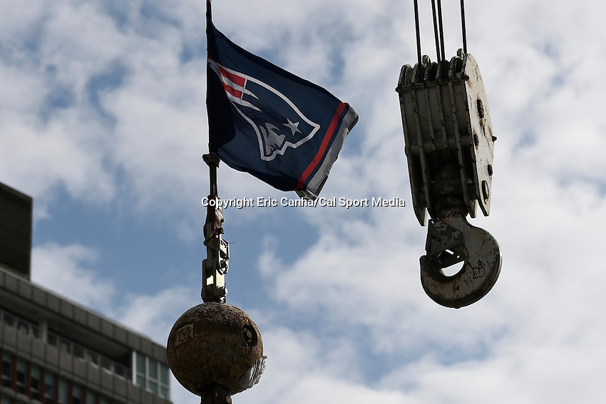 February 4, 2015 - Boston, Massachusetts, U.S. - A Patriots flag flies over the parade route in Boston to celebrate the New England Patriots victory over the Seattle Seahawks in Super Bowl XLIX. Eric Canha/CSM