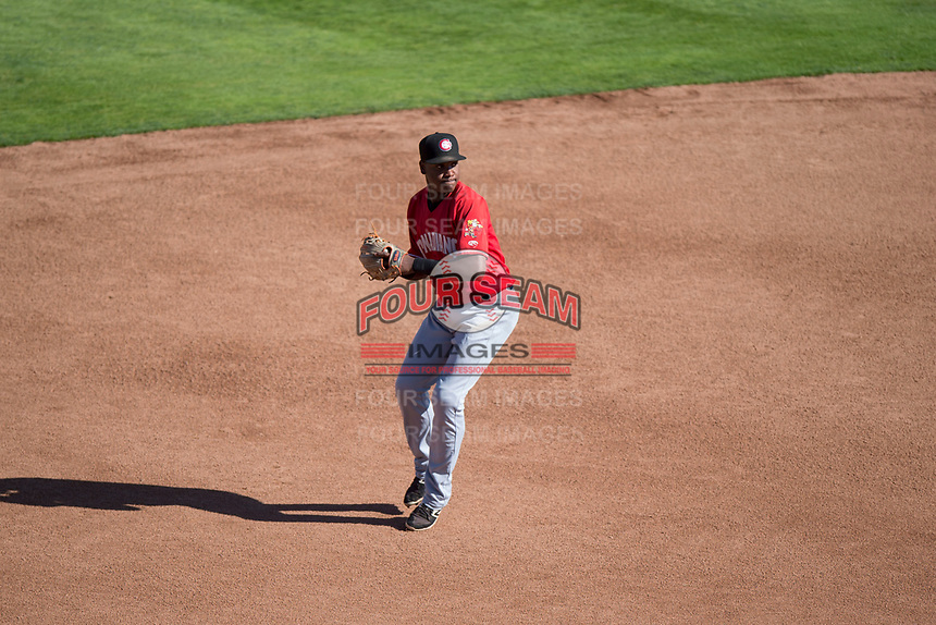 Vancouver Canadians shortstop Jesus Severino (10) prepares to make a throw to first base during a Northwest League game against the Spokane Indians at Avista Stadium on September 2, 2018 in Spokane, Washington. The Spokane Indians defeated the Vancouver Canadians by a score of 3-1. (Zachary Lucy/Four Seam Images)