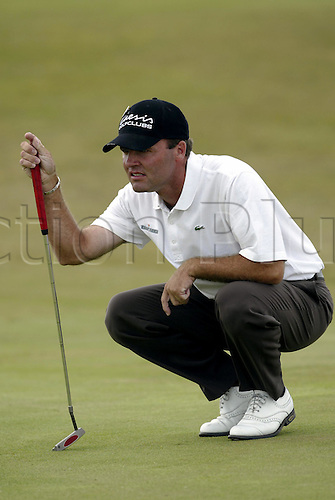 July 20, 2003: THOMAS LEVET (FRA) lines up his putt on the 2nd green, The Open Championship, Royal St George's Golf Club Photo: Neil Tingle/Action Plus...British 2003 golf golfer putts putting putter putters greens 030720