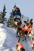 Martin Buser team mushes out of McGrath Chkpt onto Kuskokwim River 2006 Iditarod Interior AK Winter