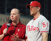 Philadelphia Phillies pitcher Brad Lidge is interviewed my Tom McCarthy following his save against his former team on Thursday May 22nd at Minute Maid Park in Houston, Texas. Photo by Andrew Woolley / Four Seam Images..