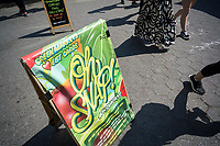 A sign in the Union Square Greenmarket in New York informs patrons that the market accepts the SNAP program and the use of EBT cards, seen on Saturday, June 10, 2017. The paperless Electronic Benefits Transfer, which replaced food stamps, have become popular in the Greenmarkets allowing people on public assistance convenient access to fresh fruits and vegetables. (© Richard B. Levine)