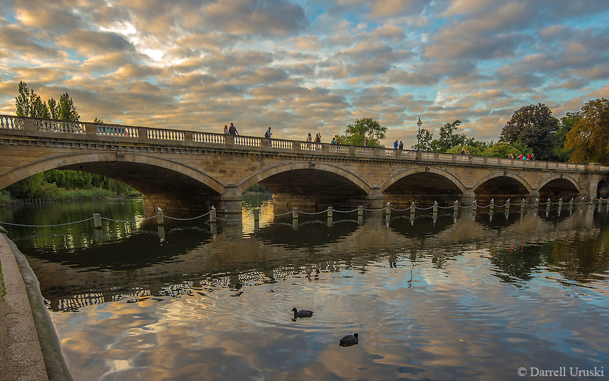 Sunset photograph of the Serpentine Bridge which is located in Hyde Park in London England. <br />