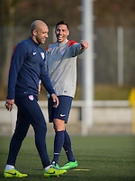 Frankfurt, Germany - Sunday, March 2, 2014: The USA Men's national team practices in preparation for it's match against Ukraine. Tim Howard and Geoff Cameron share a laugh during practice.