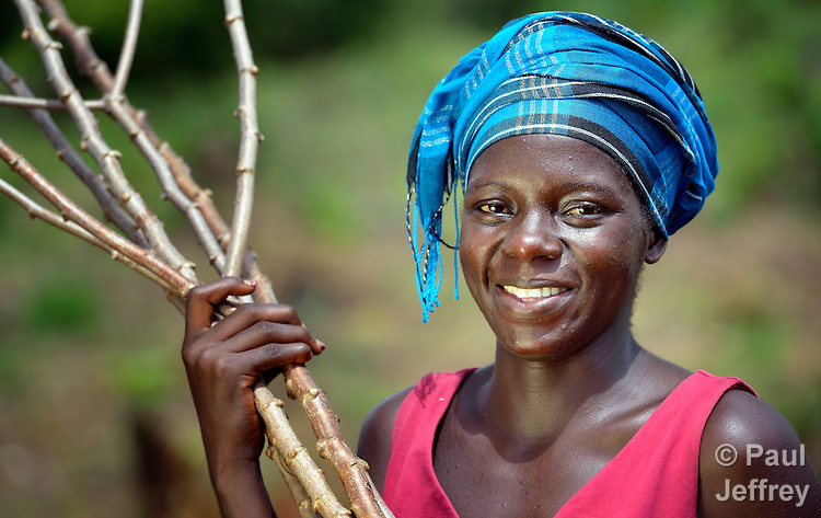 """Marion Zenneh, 23, is one of several dozen women who work together to grow cassava on a six-acre farm in Mount Barclay, Liberia. The income-generating project, called """"Say No to Poverty,"""" is administered by the National Federation of Women Employees and Allied Workers, with financial support from United Methodist Women."""