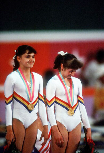 August 6, 1984; Los Angeles, California, USA;  (L-R) Artistic gymnastics stars Simona Pauca and Ecaterina Szabo of Romania share gold medal win on balance beam event final at 1984 Los Angeles Olympics. Copyright 1984 Tom Theobald
