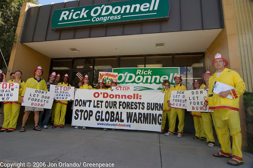 Greenpeace activists rally outside the office of the Republican candidate for District 7 in Colorado, Rick O'Donnell, to raise awareness about the threats of global warming.