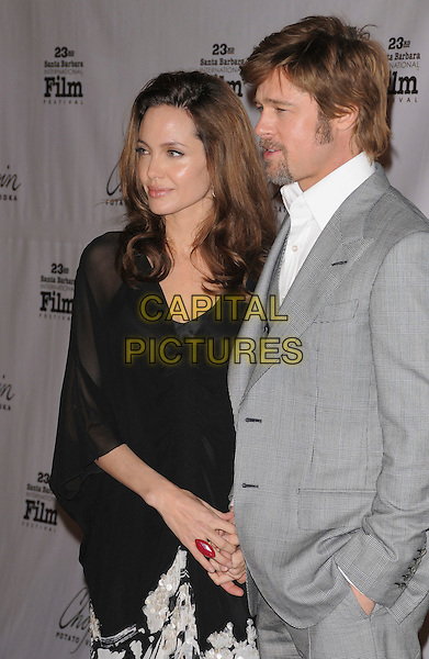 ANGELINA JOLIE & BRAD PITT.attend The 23rd Santa Barbara International Film Festival's Presentation of The Performance of the Year Award honoring Angelina Jolie held at The Arlington Theatre in Santa Barbara, California, USA, February 02 2008..half length grey gray suit jacket waistcoat black sheer dress shirt top couple red ring.CAP/DVS.?Debbie VanStory/Capital Pictures