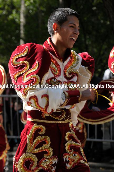 The Hispanic Parade in New York City. A boy representing Argentina in the Hispanic Parade in New York City. A boy smiles and wears a red and gold outfit to represent Argentina in the New York City Hispanic Parade.