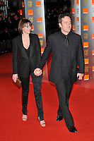 KEELEY HAWES & MATTHEW MACFADYEN.The Orange British Academy Film Awards 2009, Royal Opera House, Covent Garden, London, England, February 8th 2009..BAFTAS arrivals full length black suit tie trouser blazer jacket husband wife holding hands trousers gold clutch bag .CAP/PL.©Phil Loftus/Capital Pictures