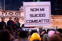"Danilo Calvani, uno dei leader del Movimento dei Forcon, parla durante la manifestazione contro le politiche di austerita' del governo, le tasse e la disoccupazione, in Piazza del Popolo a Roma, 18 dicembre 2013.<br /> Pitchforks Movement's coordinator Danilo Calvani speaks during a demonstration against government's austerity measures, taxes and unemployment in Rome, 18 December 2013. The sign reads ""I don't suicide myself, I fight"".<br /> UPDATE IMAGES PRESS/Riccardo De Luca"