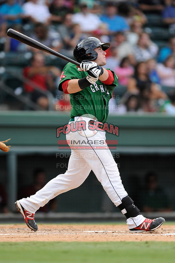 Catcher Jordan Procyshen (29) of the Greenville Drive bats in a game against the Savannah Sand Gnats on Sunday, August 24, 2014, at Fluor Field at the West End in Greenville, South Carolina. Greenville won, 8-5. (Tom Priddy/Four Seam Images)