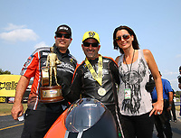 Sep 4, 2017; Clermont, IN, USA; NHRA pro stock motorcycle rider Eddie Krawiec (center) celebrates with crew chief Matt Hines (left) and wife Anne Marie Krawiec after winning the US Nationals at Lucas Oil Raceway. Mandatory Credit: Mark J. Rebilas-USA TODAY Sports