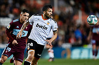 1st February 2020; Mestalla, Valencia, Spain; La Liga Football,Valencia versus Celta Vigo; Ezequiel Garay of Valencia CF follows the ball challenged by Gabriel Fernandez of Celta