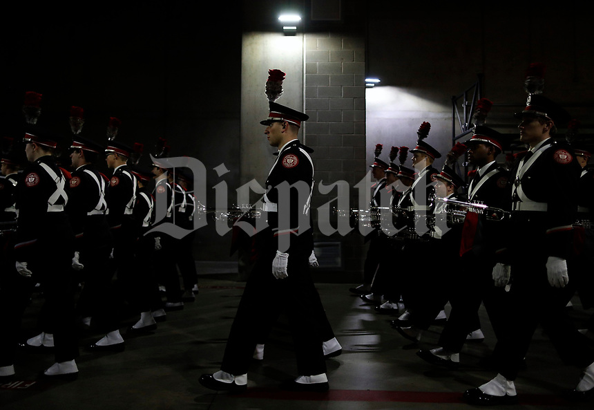 Ohio State Buckeye Marching Band march together under the stadium before the 82nd Goodyear Cotton Bowl Classic at AT&T Stadium in Arlington, Texas on December 29, 2017.  [Kyle Robertson/Dispatch]