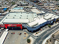 Soriana shopping centers on Colosio Boulevard. Building. City. Architecture. Increase. Modernity. Real state development. Costoco, Soriana, Mega, Mega mall, Auto, cars, parking. Panoramic view. Hermosillo, Sonora<br />