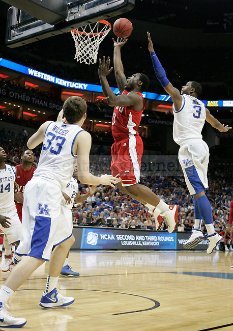 A WKU player takes a shot in the first half of the University of Kentucky game against Western Kentucky University in the second round of the NCAA Tournament, in the KFC Yum! Center, on Thursday, March 15, 2012 in Louisville, Ky.  Photo by Latara Appleby | Staff .