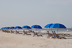 Beach umbrellas dot the beach and offer shade and relaxation.