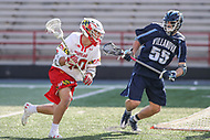 College Park, MD - March 18, 2017: Maryland Terrapins Connor Kelly (40) runs by Villanova Wildcats Joey Froccaro (55) during game between Villanova and Maryland at  Capital One Field at Maryland Stadium in College Park, MD.  (Photo by Elliott Brown/Media Images International)