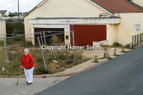 Jaywick Essex Uk boarded up amusement arcade senior poverty in coastal town. 2013