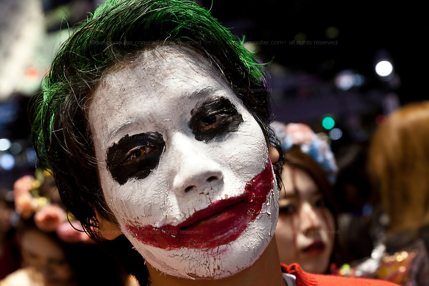 A young man dressed as The Joker from the batman movies to celebrate Halloween in Shibuya, Tokyo, Japan. Thursday, October 31st 2013