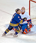 9 December 2006: Buffalo Sabres center Derek Roy (9) watches a high rebound against Montreal Canadiens goaltender Cristobal Huet (39) of France at the Bell Centre in Montreal, Canada. The Sabres defeated the Canadiens 3-2 in a shootout, taking their third contest in the month of December. Mandatory Photo credit: Ed Wolfstein Photo<br />  *** Editorial Sales through Icon Sports Media *** www.iconsportsmedia.com