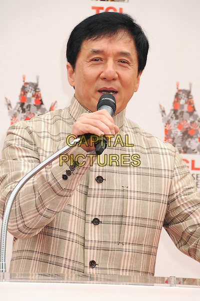 Jackie Chan<br /> Jackie Chan Hand &amp; Footprint Ceremony held at the TCL Chinese Theatre, Hollywood, California, USA, 6th June 2013.<br /> half length plaid checked jacket microphone speaking beige <br /> CAP/ADM/BP<br /> &copy;Byron Purvis/AdMedia/Capital Pictures