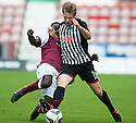 Pars' Jordan Moore is challenged by Arbroath's David Banjo.