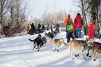 Rudy Demoski Sr. rounds the bend at the Goose Lake turn during the ceremonial start of the Iditarod sled dog race Anchorage Saturday, March 2, 2013. ..Photo (C) Jeff Schultz/IditarodPhotos.com  Do not reproduce without permission