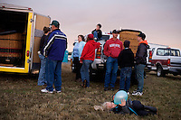 Hot air balloon pilots and owners wait for a weather report before inflating balloons at the Great Prosser Balloon Rally in Prosser, Washington, USA.