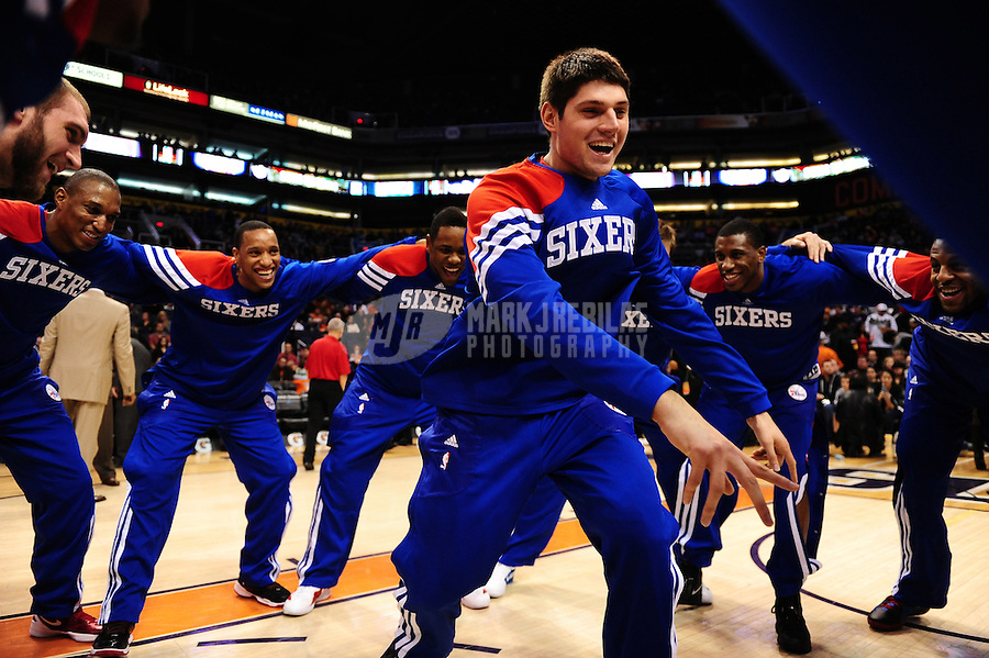 Dec. 28, 2011; Phoenix, AZ, USA; Philadelphia 76ers forward Nikola Vucevic (center) dances with his teammates prior to the game against the Phoenix Suns at the US Airways Center. The 76ers defeated the Suns 103-83. Mandatory Credit: Mark J. Rebilas-USA TODAY Sports