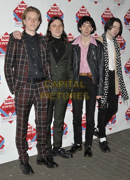 LONDON, ENGLAND - FEBRUARY 26: Peace ( Harrison Koisser, Dominic Boyce, Samuel Koisser &amp; Douglas Castle )  attend the NME Awards 2014, O2 Academy Brixton, February 26, 2014 in London, England, UK.<br /> CAP/CAN<br /> &copy;Can Nguyen/Capital Pictures