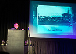 Bellmore, New York, USA. 16th July 2015. HENRY STAMPFEL, owner of Bellmore Movies, shows a 1918 photo of Bellmore Theatre, when speaking at the 18th Annual LIIFE Awards Ceremony. The Long Island International Film Festival was held at that historic theater.