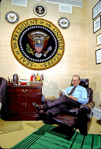 United States President Gerald R. Ford works in the Oval Office Study at the White House in Washington, D.C. sometime during March, 1975.<br /> Credit: Arnie Sachs / CNP