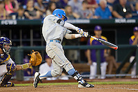 UCLA Bruin outfielder Eric Filia (4) swings the bat during Game 4 of the 2013 Men's College World Series against the LSU Tigers on June 16, 2013 at TD Ameritrade Park in Omaha, Nebraska. UCLA defeated LSU 2-1. (Andrew Woolley/Four Seam Images)
